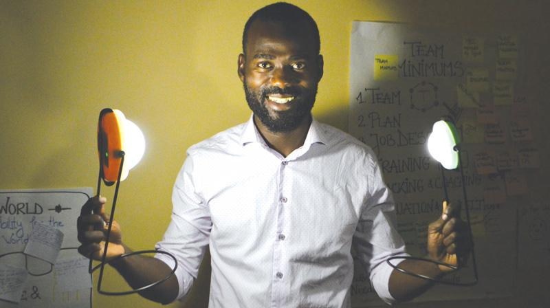 Sylver Kibelolaud Chief Executive Officer of Green Ville Solutions with the Sun King Eco an award-winning solar light from the American based company Green light Planet.