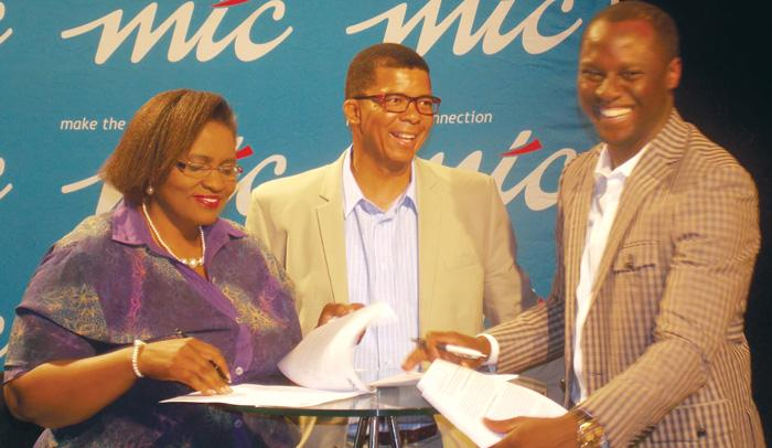 Menesia Muinjo, Chief News and Programming Officer, NBC, Cassius Moetie, Spokesperson, NPL and Tim Ekandjo, Chief Human Capital and Corporate Affairs Officer, MTC, signing a broadcast partnership. (Photograph by Mandisa Rasmeni).