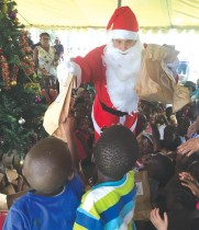 A Managing Director disguised as Santa Claus, nevertheless the children delighted in the arrival of Santa, not caring much whether it is Gunther Ling of Namibia Dairies, or Christmas Father and his elves.