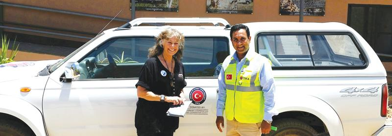 Celebrated cheetah conservator Laurie Marker (left) with Mr Cüneyt Esmer, the principal of the Turkish Cooperation and Coordination Agency, TIKA, and the donated bakkie. The Cheetah Conservation Fund based in Otjiwarongo will use the vehicle to visit conservation-minded farmers where guarddogs help protect the lives of both cheetahs and smallstock.