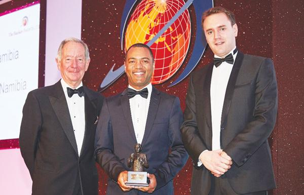 Oscar Capelao (middle), FNB's Chief Financial Officer, flanked by the editor and publisher of The Banker Magazine in London at the awards ceremony.