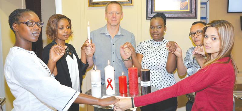 Namdeb General Manager, Riaan Burger (centre back) with Namdeb employees who joined the rest of the world to commemorate World Aids Day.