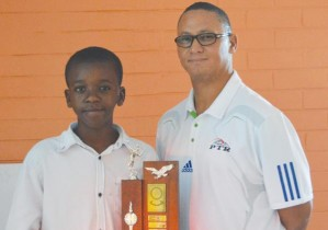 The overall winner of the intermediate category and the Academies Sportsman of the year, Mike Kambonde (left), receives his award from PTA Director and Head Coach Romeo van Wyk.