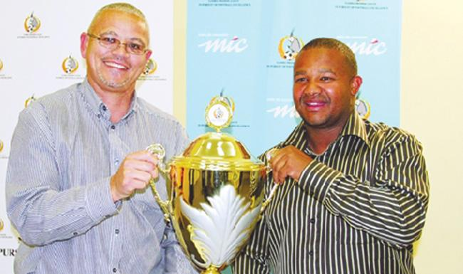 Otto Landsberg (left), who has resigned as Assistant Coach for Black Africa with Woody Jacobs, Head coach Black Africa, with the MTC/Premiership Cup.