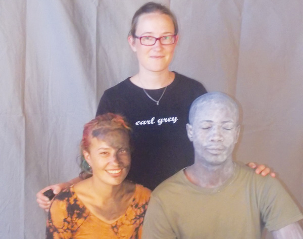 Tina Schönheit, standing at the back, is the artist. Seated in front are her two models Kristin (left) and Ernest (right) whom she painted to the opposite of their skin colour. (Photograph by Mandisa Rasmeni).