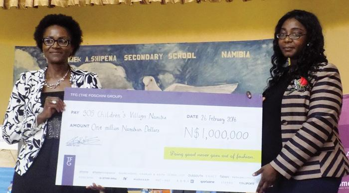 Foschini Group Namibia's Director Elize Hangula and SOS Director Simonee Shihepo with the N$1 million cheque. The money is sponsored by Foshinis to help upgrade education standards at two Windhoek schools. (Photograph by Donald Matthys)