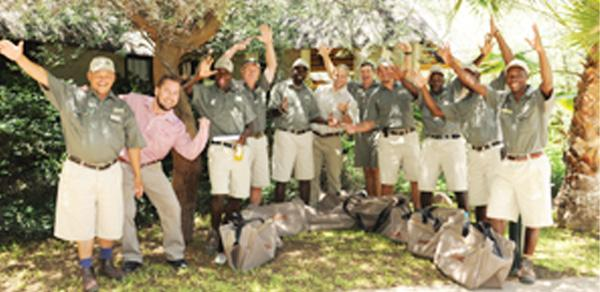 Celebrating after the awards ceremony at Erindi Private Game Reserve, are from left, Frederik Witbooi from the Gondwana Fish River Canyon Lodge, Gerhard Beyleveld of Distell (Amarula), Sheldin Naruseb from Erindi, Stephen Croucamp from Erindi, Karitjangua Day Kasupi from the Wilderness Safaris Hoanib Skeleton Coast Camp, Malcolm Moore of Distell, Gerhard van Niekerk from EcoTraining, Francois du Plessis from Erindi, Reginald Koper from the Wilderness Safaris Doro Nawas Camp, Johannes Kapenda from the Wilderness Safaris Serra Cafema Camp and Rector Tetuka from Gondwana Namushasha River Lodge. (Photograph by Vera Botha)