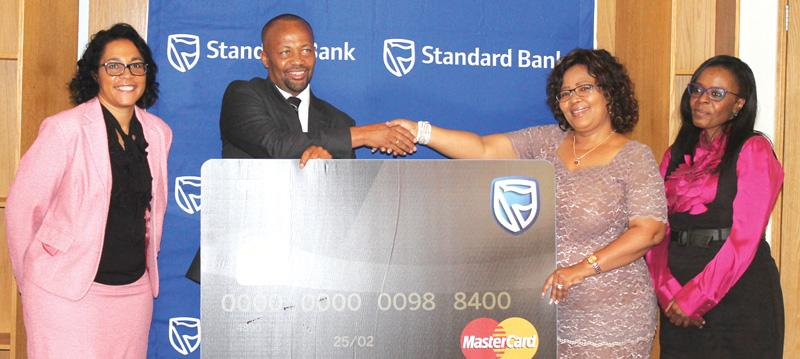 From the left are Standard Bank's Head of Marketing Jacquiline Pack, the bank's Chief Executive Vetumbuavi Mungunda, the Minister of Education, Arts and Culture, Hon Katrina Hanse-Himarwa and Standard Bank's Company Secretary and Head of Corporate Social Investment, Sigrid Tjijorokisa.