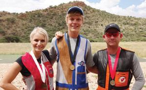 Gaby Ahrens (3rd), Oliver Hoffmann (1st) and Ian Kriel standing from left to right after the tournament.