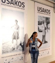 Saara Ilovu, Usakos Local Economic Development Officer in front of exhibition banners.