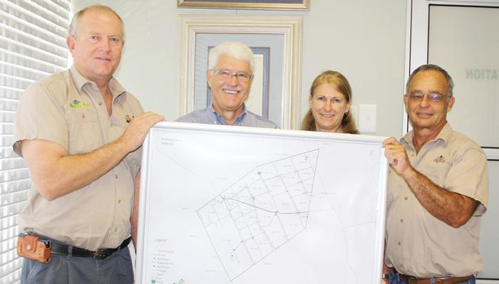 Agra Provision's Frank Wittneben (left), together with Dr Pauline Lindeque and Dr Fonnie Bruwer (right), presented well-known Bonsmara breeder, Dr Joggie Briedenhann (centre left) with his set of detailed farm maps for Farm Hartebeestloop.