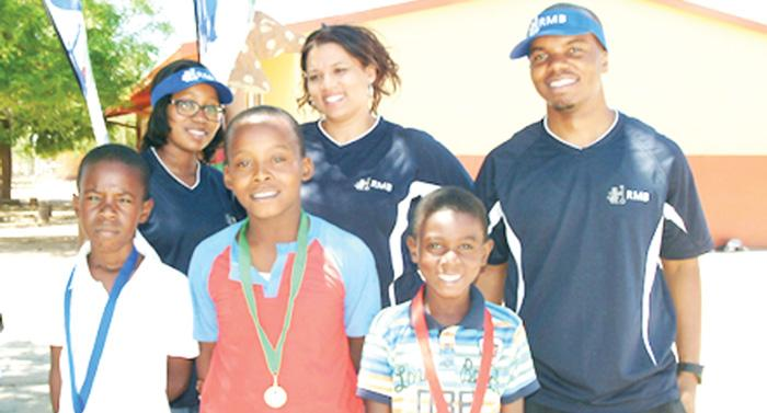 Ray Auala (right), chairman of RMB's CSI wing with the best performers at the BMX early rider development programme hosted at the Jackson Kaujevo Centre in Okahandja.