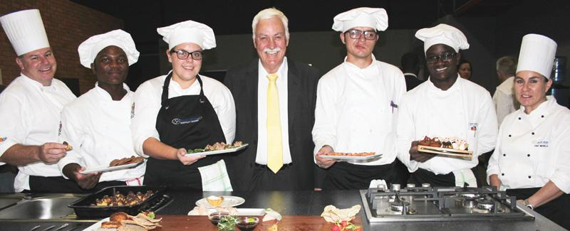 Terry Jenkinson (left), Tom Mutavdzic (centre) and Michelle Fourie (right) with the first intake of trainee chefs at the new Silver Spoon Hospitality Academy in Windhoek.