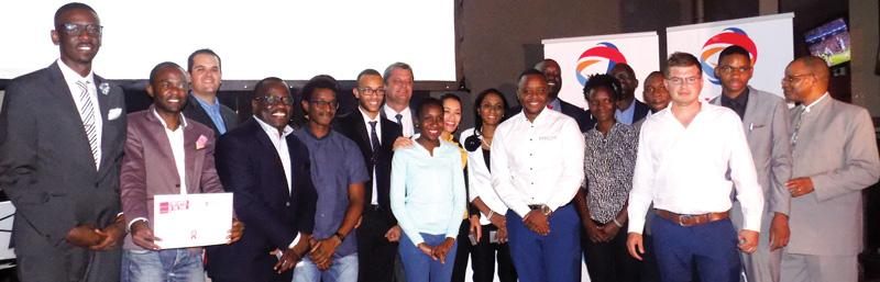 Collin Nico /Uirab (left) won the N$250,000 purse in the Start-upper of the Year challenge by downstream fuel company, Total. He received his prize at a sumptuous ceremony on Tuesday this week. Tarah Shaanika, the CEO of the Namibia Chamber of Commerce and Industry, stands fourth from left and the deputy Minister of Industrialisation, Trade and SME Development, Hon Piet van der Walt is at the back (centre left) while Bank Windhoek's MD designate, Baronice Hans is at centre right and next to her, Naftal Kakwambi, Managing Director TOTAL Namibia. (Photograph by Musa Carter).