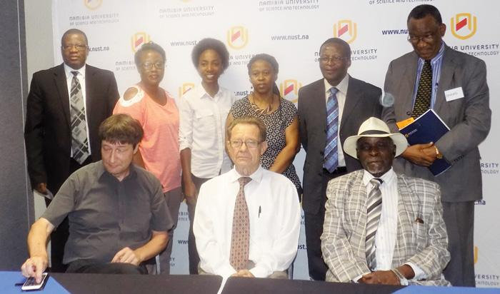 Seated (l-r) Dr Johanness Heeb, Senior Partner of Seecon International GMBH, Dr Gert Gunzel, Deputy Chancellor of Administration and Finance at The Namibia University of Science and Technology (NUST) and Right Honourable Nahas Angula, with staff members of NUST, (back row) who witnessed the signing of a Memorandum of Agreement between NUST and Seecon International GMBH (Photograph by Mandisa Rasmeni).