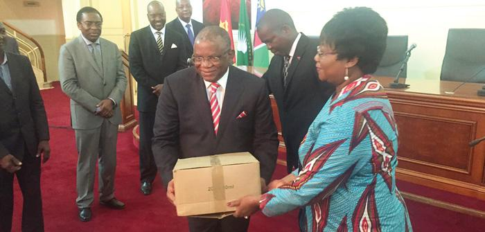 Her Excellency Grace Uushona, the Namibian Ambassador to Angola presenting the Angolan Minister of Health, HE Luis Gomes Sambo with a gift of medicine from the Namibian people. Witnessing the event is the Angolan Minister of External Relations, HE Georges Chikoti. Angola has experienced an outbreak of Yellow Fever for which the country's cash-strapped government was not prepared. The Ambassador expressed her condolences to the Angolan Government for the people who have succumbed to the disease.