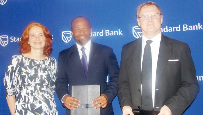 The IFC deputy Treasurer based in London, Georgina Baker (left) and the Manager of its Financial Institutions Group for sub-Saharan Africa, John Wilson (right) with the Chief Executive of Standard  Bank Namibia, Vetumbuavi Mungunda. The International Finance Corporation provided the N$180 million funding for Standard Bank's employee share ownership scheme. (Photograph by Mandisa Rasmeni).