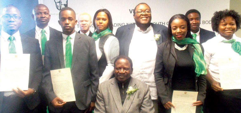 The new Board of the National Youth Council of Namibia with Honourable Jerry Ekandjo, (seated) Minister of Sport, Youth and National Service. (l-r) Lot Ndamanomhata, Bensen Katjirijova, Alfeus Kapolo, Orben Mututi, Beatrice Kotungondo, Mandela Kapere, Chairperson, Dalah Haplulile, Kaveriua Marwenga and Elsarien Katiti. (Photograph by Mandisa Rasmeni).