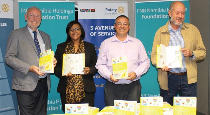 From the left, President of Rotary Club Windhoek, Dr. Frank Schwardmann and FNB's Corporate Social Investment Manager, Revonia Kahivere, with Schalk Walters and Cyril Lowe from the Amos Meerkat Schools national pre-school project.