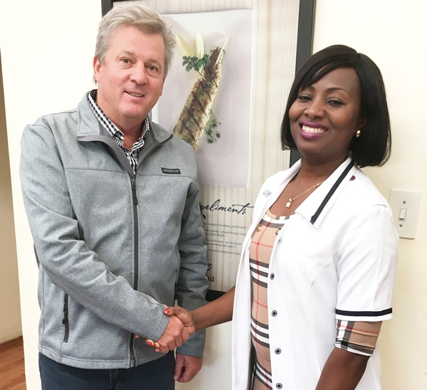 Hangana Seafood Managing Director, Herman Theron (left) with Stella Mwenyo, a registered nurse who works at the Hangana Seafood on-site clinic.