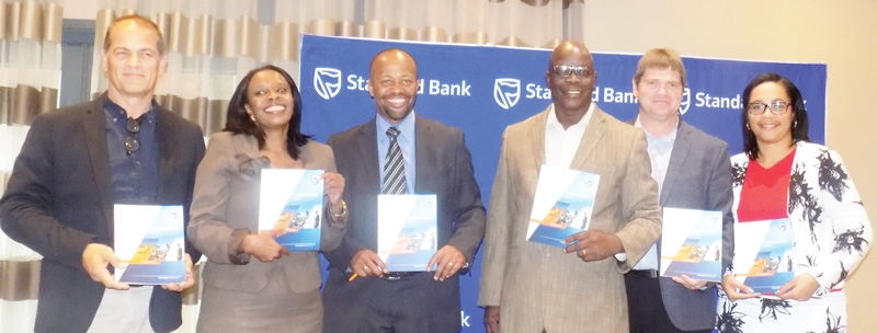 Vetumbuavi Mugunda (third from left), Chief Executive of Standard Bank Namibia, with staff members of the Bank at the launch of their 2015 Sustainability Report. (Photograph by Mandisa Rasmeni).