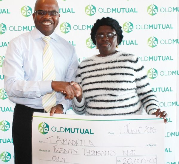 Kosmas Egumbo (left), Group CEO of Old Mutual Namibia with Mrs. Toini Amadhila, who won an all expenses paid holiday at the Tourism Expo.