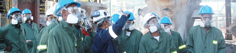 Captivated... The group of learners and teachers from Windhoek's Pioneers Boys School who toured Dundee Precious Metals Tsumeb's smelter look on in astonishment as the smelting process is explained in detail.