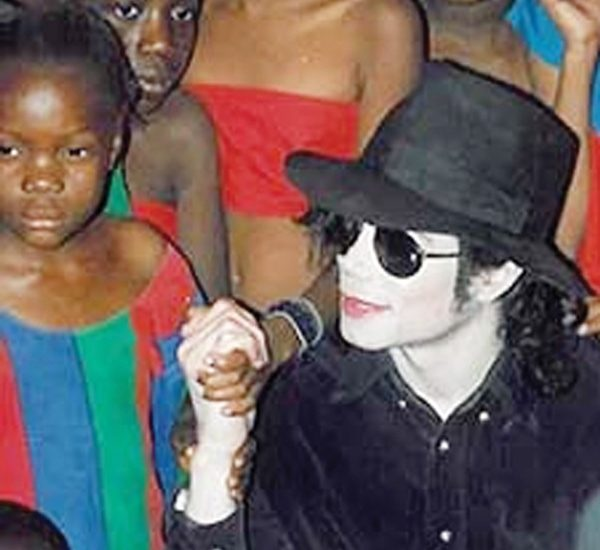 Ebony and bleached ivory, Michael Jackson making new friends during his 1998 visit to Namibia.