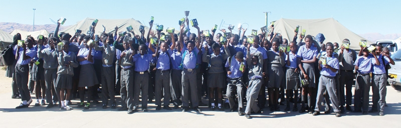 Learners at Tobias Hainyeko project school celebrating their solar lights, a gift from Namib Mills. The miller donated 210 portable solar lights as part of their Edu-light programme to enable the learners to study during evenings. The Tobias Hainyeko learners are mostly from the informal settlements in the area where the lack of access to electricity is a common problem.