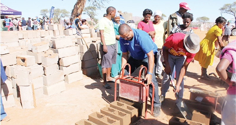 There was no end to the enthusiasm and community participation when Standard Bank employees descended on Rehoboth with brickmaking machines and cement to start making bricks for the residents of Burgershoek and Kavukiland so that they can start building their own homes.