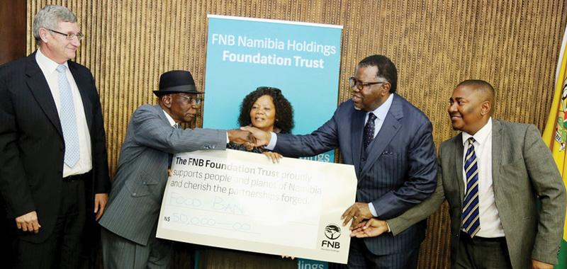 President HE Dr Hage Geingob received the first donation from the FNB Foundation as a contribution to strengthen the national Food Bank. FNB Namibia CEO, Sarel van Zyl (left), witnessed the event.