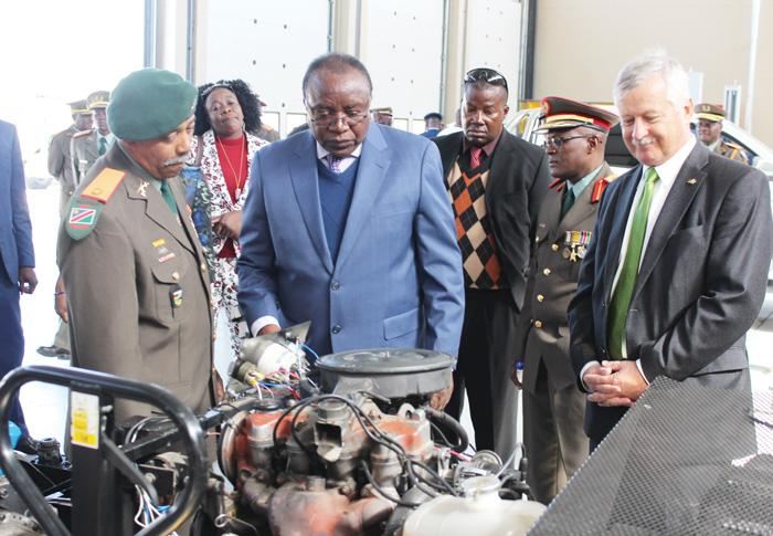 Deputy Minister of Defence, Mr. Billy Mwaningange and Ambassador Christian Schlaga inspecting the vehicle repair and training workshop.