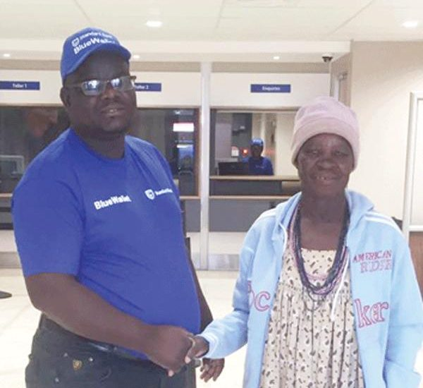 Lucia Ananias (right), a 75-year-old pensioner from Ruacana was the first Standard Bank client to make us of the bank's new Service Centre in Ruacana. Welcoming her at the bank, is the Outapi branch manager, Geraldus Kazondunge. The Ruacana service centre is a satellite of the Standard Bank Outapi branch.