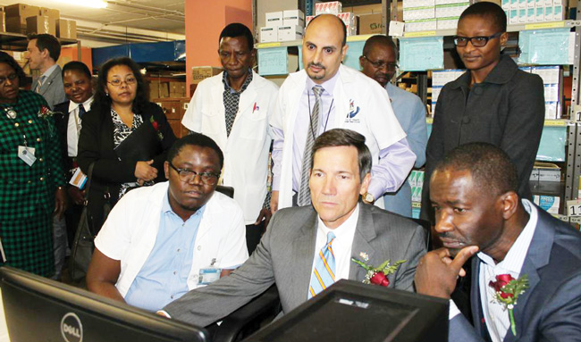 U.S. Ambassador Thomas Daughton and the Minister for Health and Social Services, Dr. Bernard Haufiku, test the new web-based computer system to manage medicine stocks at the main pharmacy of the Windhoek Central Hospital.