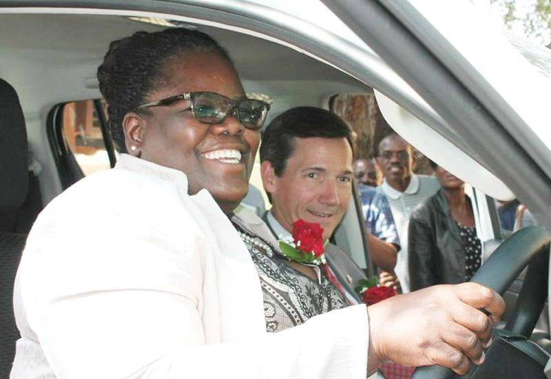 Deputy Minister of Health and Social Services, Hon Juliet Kavetuna and US Ambassador Thomas Daughton, are delighted with the new bakkies that will take HIV/AIDS workers around in rural areas.