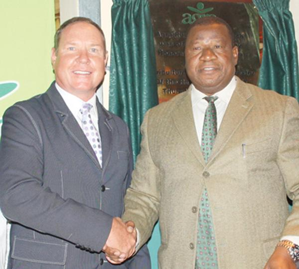 Lets shake on it:  Arnold Klein, Agra CEO (left) shaking hands with Hon. John Mutorwa, the Minister of Agriculture, Water and Forestry during opening of Agra's 20th branch in Runndu.