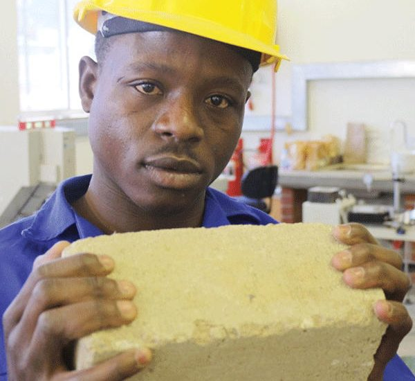 KAYEC engineer showing some of the project's results in Rundu