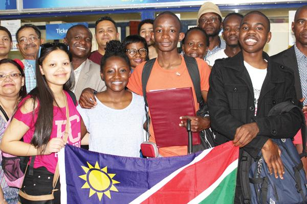 (front row, from left to right) Ms Lindsay van der Merwe, Ms Kabuba Masule, Mr Rodriquess Mauha and Mr Vilho Nanyoka at the airport together with friends and family