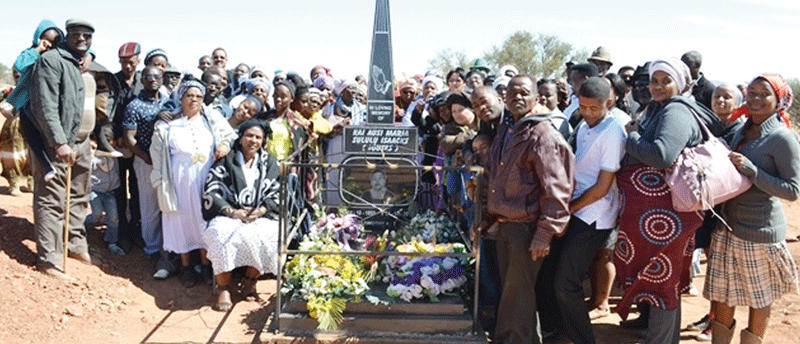 Family, family and mourners posed in front of the lonely grave of the late Maria Sululu Isaaks after her burial and tombstone unveiling over the weekend at Farm Versailles.