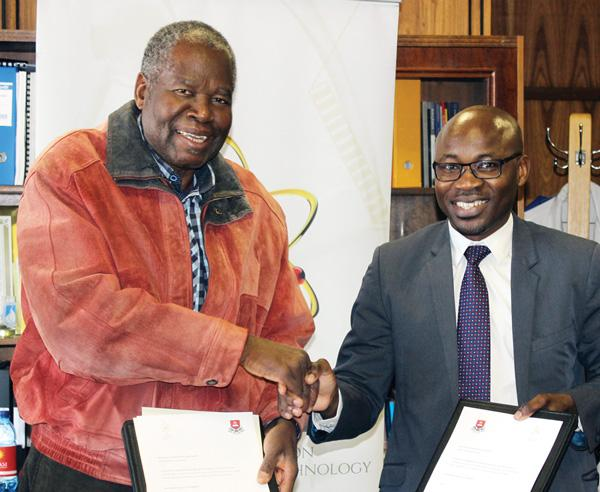 Prof. Lazarus Hangula (left), the UNAM Vice Chancellor and Dr Eino Mvula, the chief executive of the National Commission on Research, Science and Technology, this week signed a Master Agreement on Grant Management to support the university's research output.