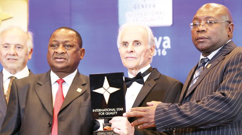Chairperson of the National Council for Higher Education, Dr Kalumbi Shangula, and the organisation's Executive Director, Mocks Shivute receive the International Star Award for Quality in the Gold category from the President of BID, Jose E. Prieto.