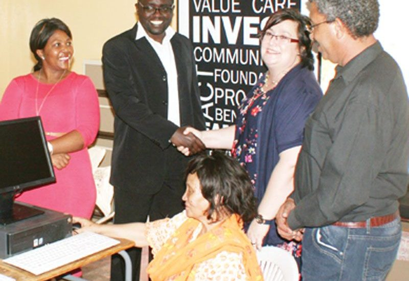 from left to right: Annaliza Goagoses; WAD Hardap Training Centre Coordinator, WAD Executive Director Mr Salatiel Shinedima shaking hands with Ms Janita Von Wielligh; the Managing Director of Debmarine - Namdeb Foundation, seated on the chair with orange clothing is Hon Christina Blaauw; the Mayor of Rehoboth Town Council, behind the Mayor, Mr Whilfred Alcock; the Computer Trainer at WAD Hardap Training Centre.