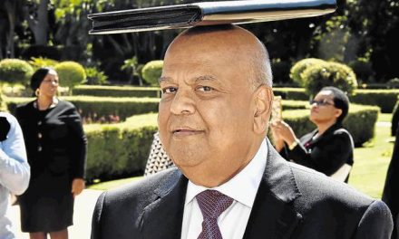 "South Africans face uncertain future as Zuma ""reshuffles"" Gordhan"