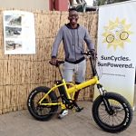 Ausiku pedals away at Tourism Expo on his own brand-new Fat-e electric bicycle