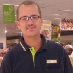 Former grocery-bag packer climbs corporate ladder