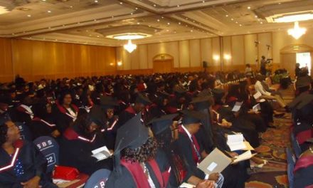 220 students capped at business school graduation