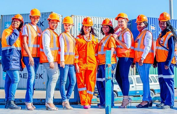 Namport women show hard hats and high heels both fashion items