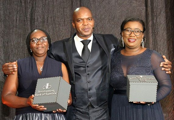 Board members Emma Haiyambo and Tabitha Mbome received personalised gifts from the Senior Manager: Corporate Communication, Jerome Mutumba, to show the lending institution's gratitude to its board members.