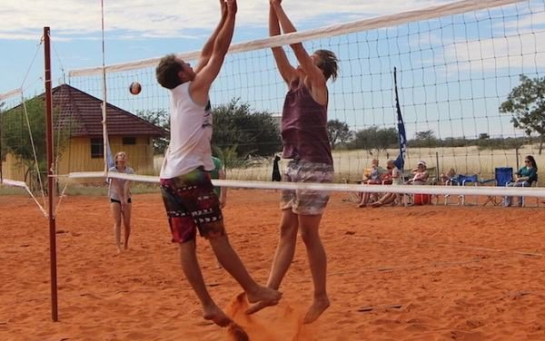 Half a dune moved for beach volleyball in deep, hot, red Kalahari sand