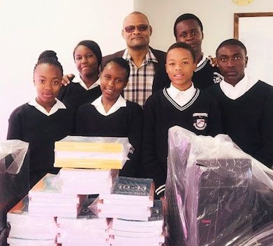 Karundu Secondary School advances with new computers, text books and cash contribution